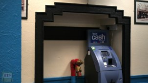 A fire hydrant can be seen on the left of the cash machine.