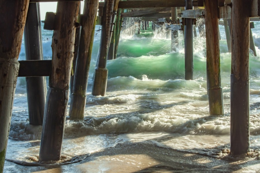 Under The San Clemente Pier View of Green Waves