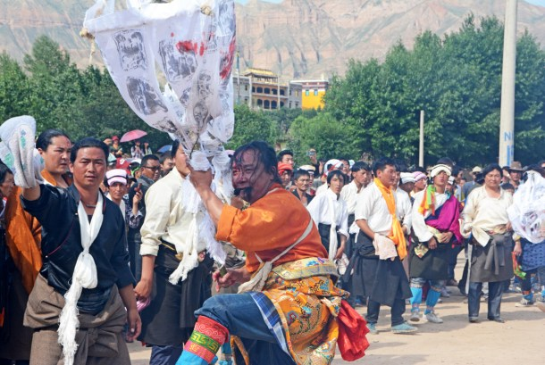 Tibetan Lha-ba, Mountain God Amyes-lhari, temporarily manifested in a human medium, performs after he cut his forehead with a knife.