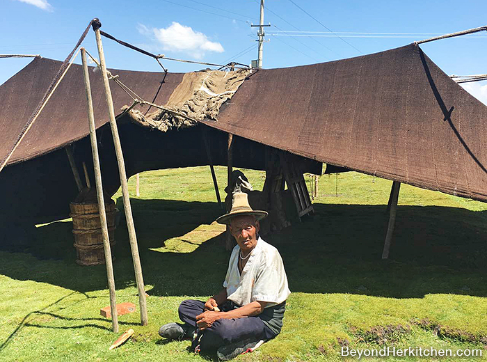 Yak hair tent, nomad man, butter churner