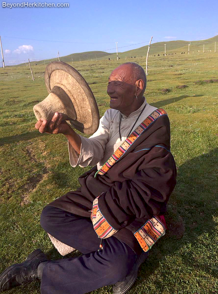Tibetan nomad man in traditional cloth