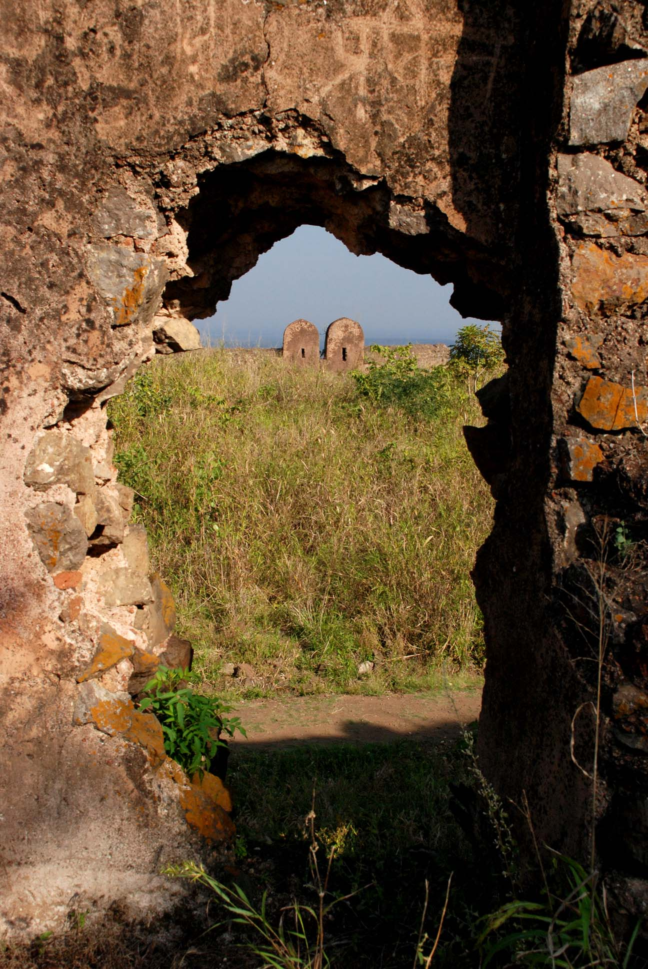 through the hole in the wall
