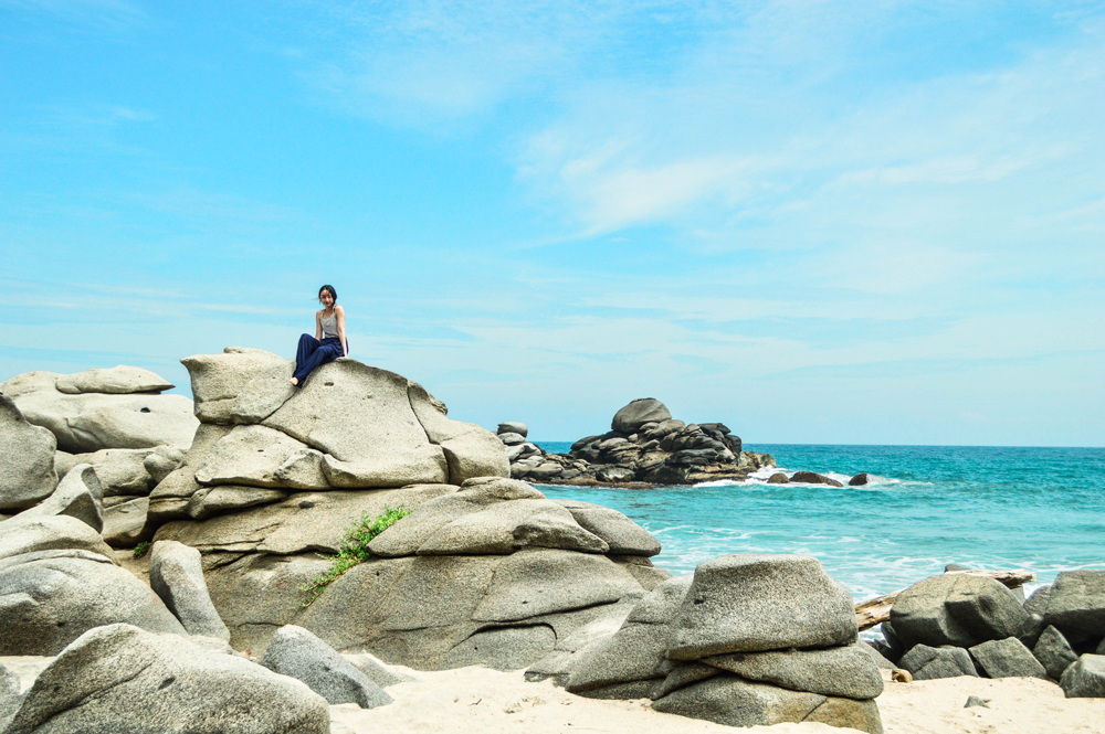 Beautiful blue sky in Tayrona Park. I'm sitting on some huge boulders.