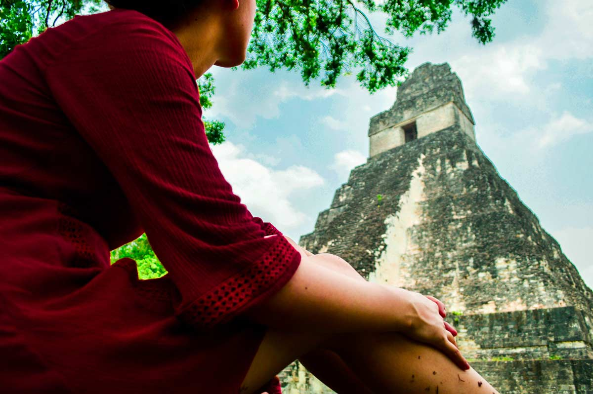 a view of Tikal Temple I-Temple of the Great Jaguar with a person in the front