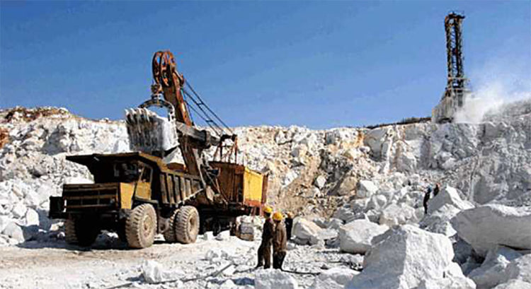 A large ore haul truck being loaded by shovels at the Taehung Youth Hero Mine. (Naenara, April 12, 2013)