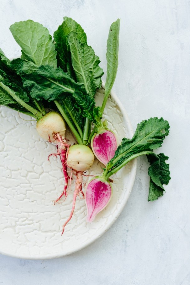 watermelon radishes on white plate