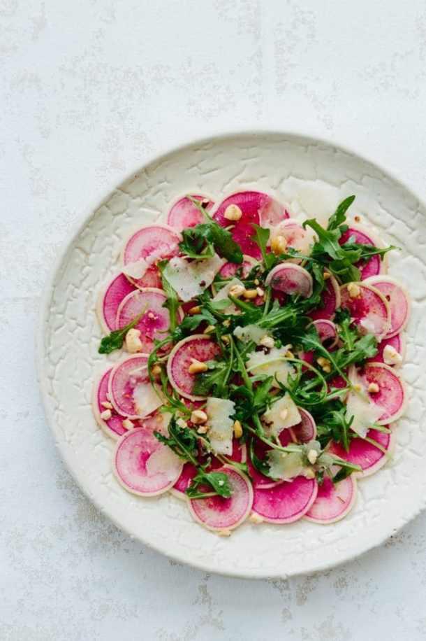 watermelon radish and arugula salad on plate