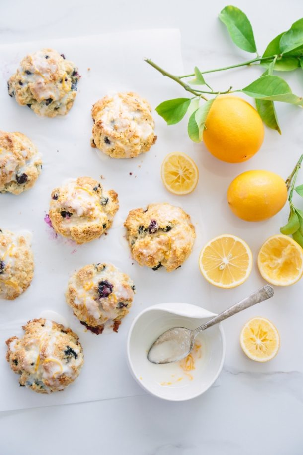 blueberry and Meyer lemon scones with Meyer lemons and a bowl of glaze