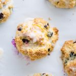glazed blueberry and Meyer lemon scones on baking sheet