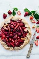 strawberry rhubarb mascarpone galette with cutting knife and strawberries