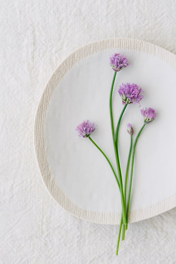 chive blossoms on white plate