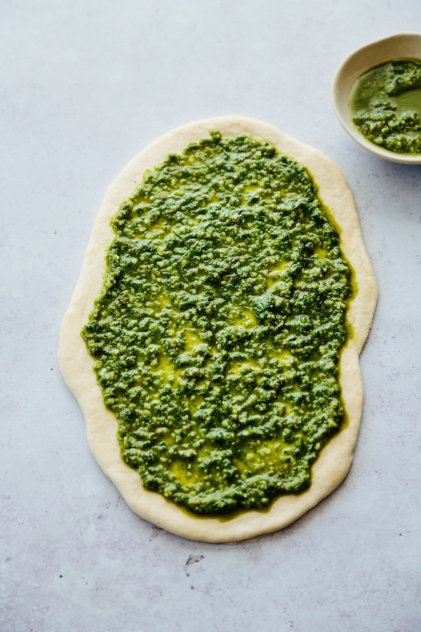 pizza base with pesto