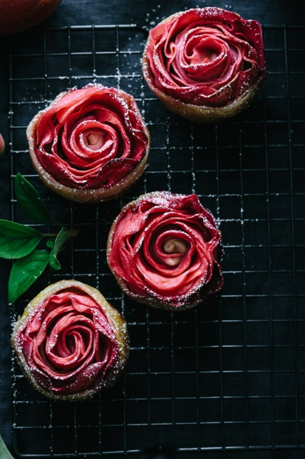 four hidden rose apple tarts on cooling rack