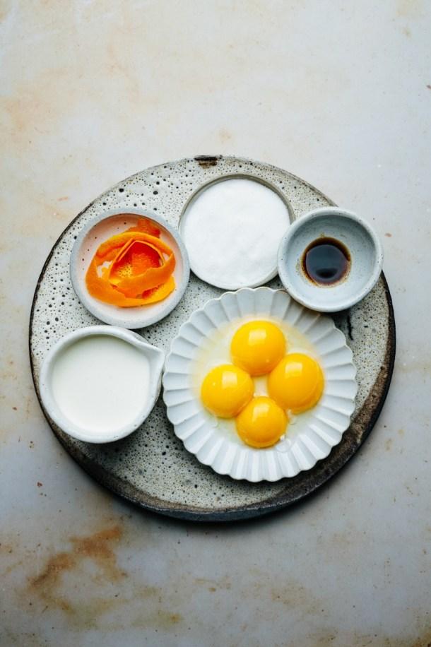 ingredients for blood orange creme brulee: heavy cream, egg yolks, vanilla bean paste, sugar, and orange strips