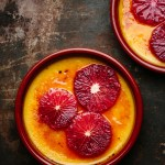 blood orange creme brulee topped with fresh blood orange slices in ramekins