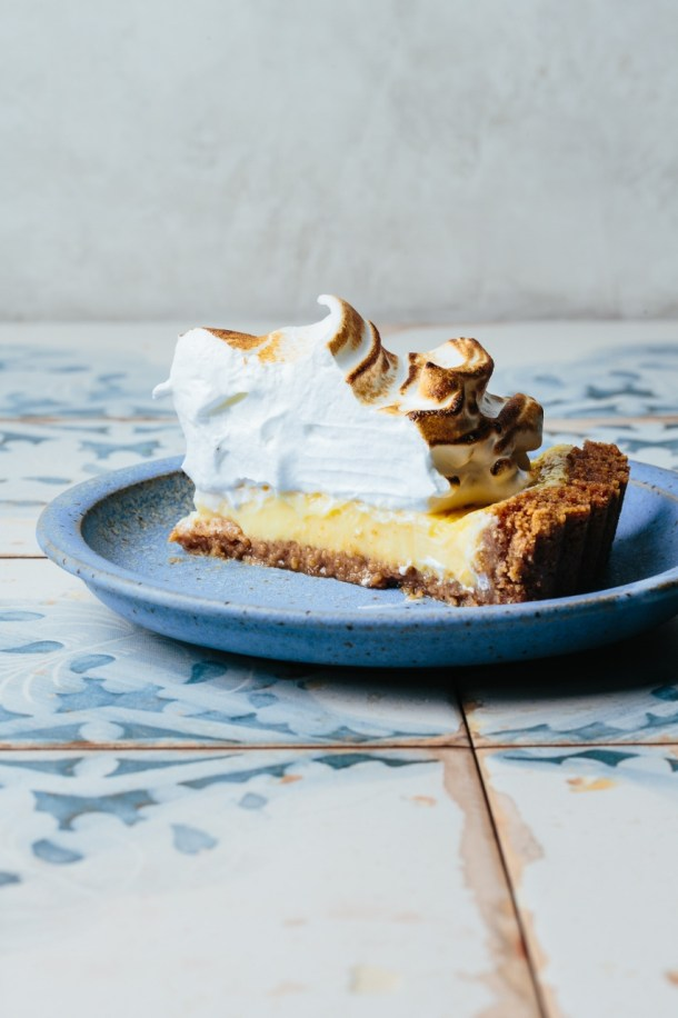a slice of lemon meringue tart on a plate