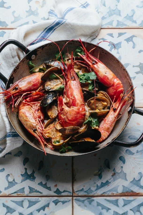 a pot of Vietnamese lemongrass coconut seafood soup and linen next to the pot