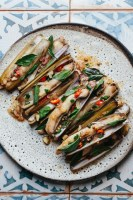 a plate of cooked tamarind razor clams