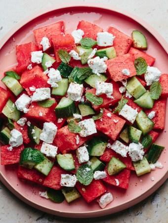a plate of cucumber watermelon feta salad