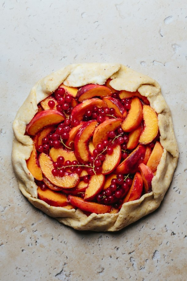 an unbaked red currant peach galette
