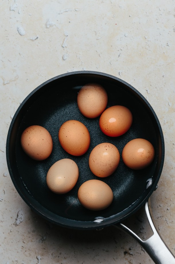 a pot of water with 8 boiled eggs