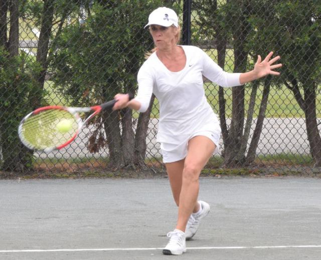 Christine Murphy Foltz hitting a forehand on a tennis court