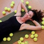 yoga teacher with tennis balls