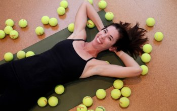 yoga teacher with tennis balls