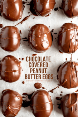 Chocolate Covered Peanut Butter Eggs | Close up overhead photo of chocolate covered peanut butter eggs on a baking sheet with one removed | Image and Copyright Policy: © Beyond the Butter, LLC