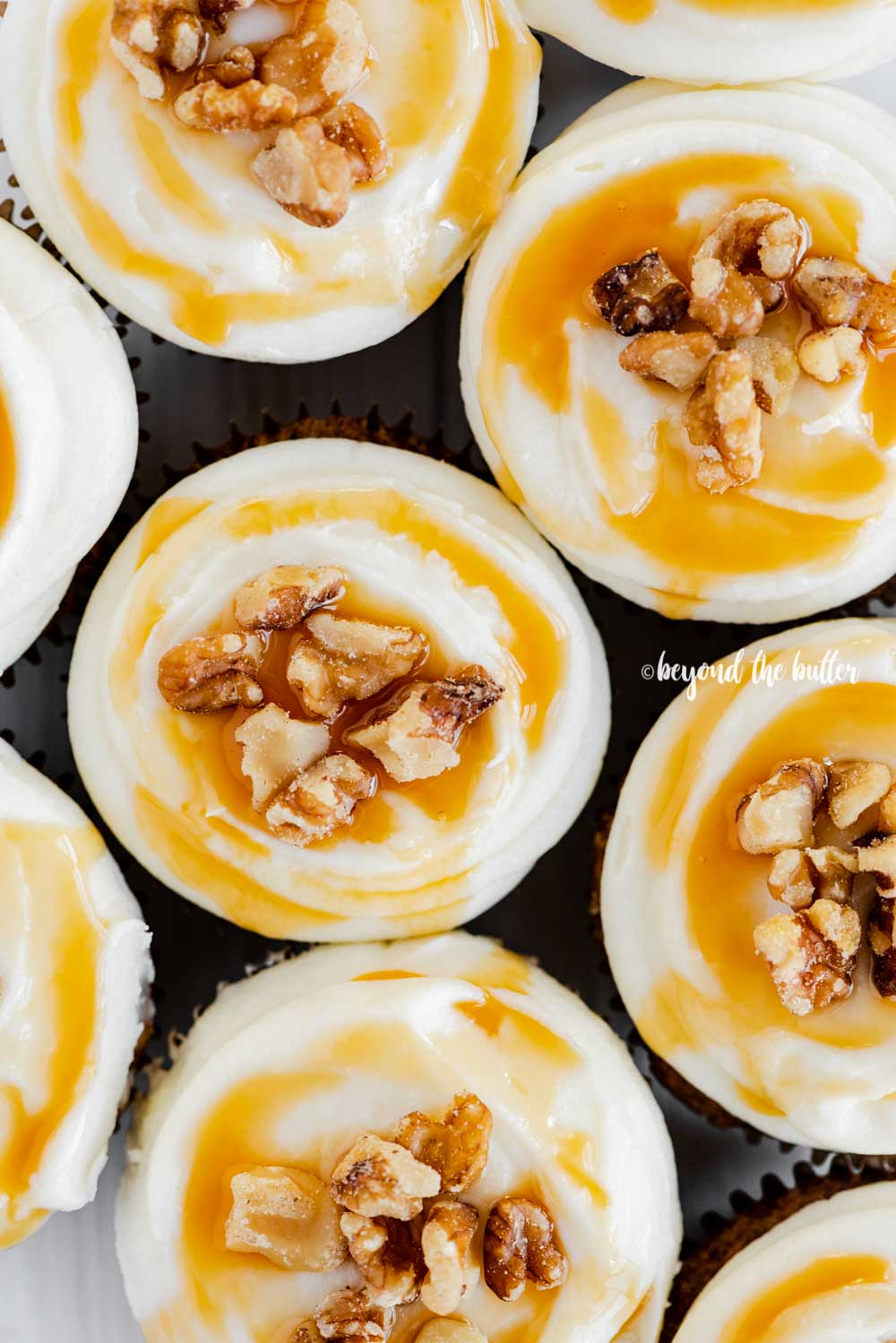 Overhead closeup image of Carrot Cake Cupcakes | © Beyond the Butter™