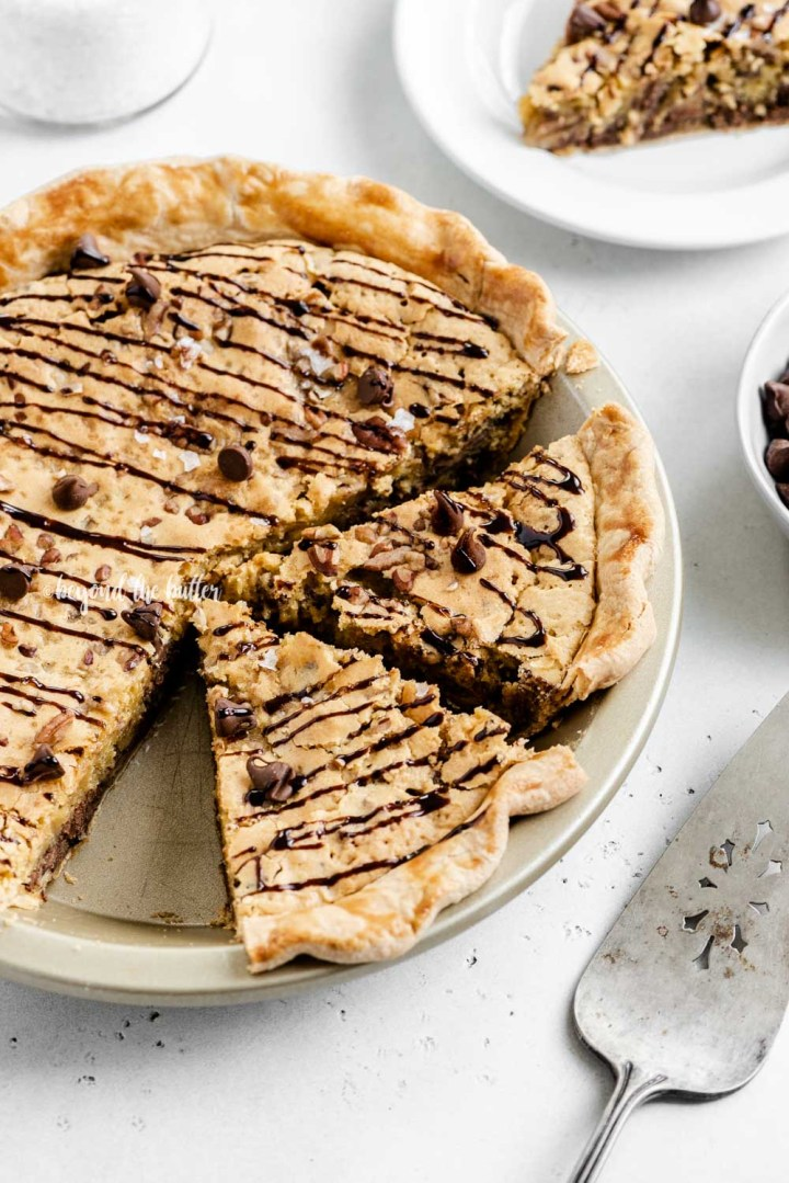 Overhead angled image of chocolate chip pie with 2 slices cut | All Images © Beyond the Butter™