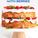 Image of homemade angel food cake with berries on a cake stand | All images © Beyond the Butter™
