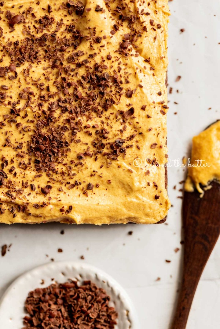 uncut fudgy chocolate brownies frosted with pumpkin buttercream | All Images © Beyond the Butter™