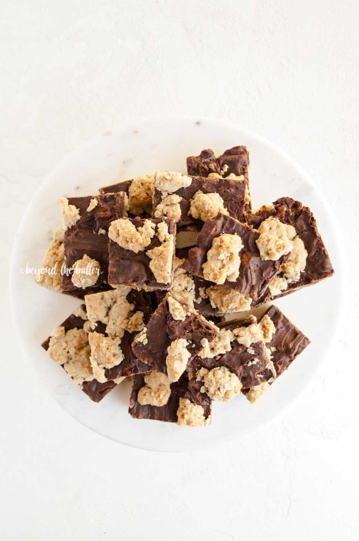 Plate of cut fudge nut bars piled high   All Images © Beyond the Butter™