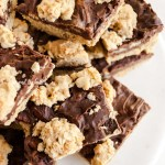 Closeup overhead image of plate of cut fudge nut bars piled high | All Images © Beyond the Butter™