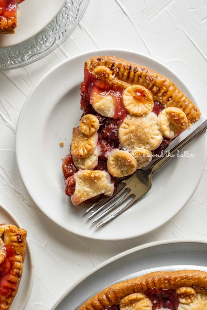 Slices of homemade cherry pie on dessert plates | All Images © Beyond the Butter™
