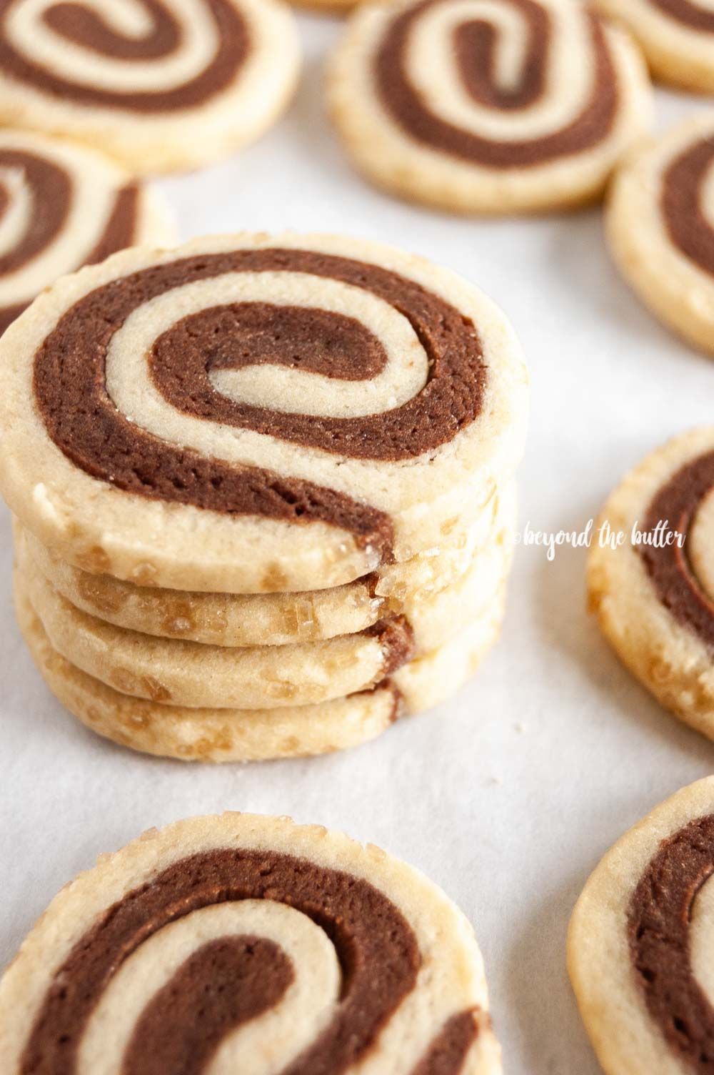 Close up image of small stack of Chocolate Pinwheel Cookies | All images © Beyond the Butter™