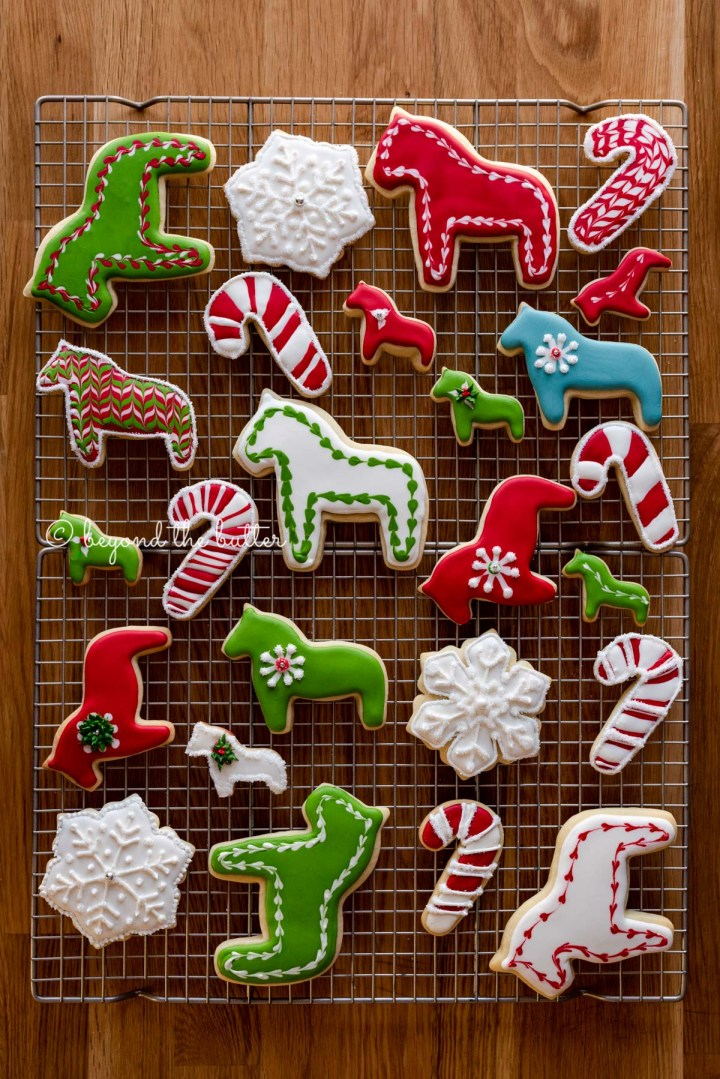 Super soft cut out sugar cookies on a wire cooling rack | All Images © Beyond the Butter®