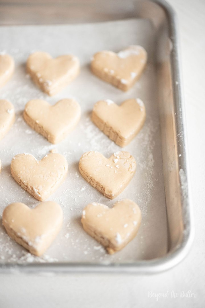 Chocolate Covered Peanut Butter Hearts | Peanut butter hearts cut out and placed on tray ready to be dipped in chocolate | Image and Copyright Policy: Beyond the Butter, LLC