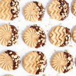 Chocolate Dipped Peanut Butter Cookies | Overhead shot of chocolate dipped peanut butter cookies with chopped peanuts scattered over top | Image and Copyright Policy: © Beyond the Butter, LLC