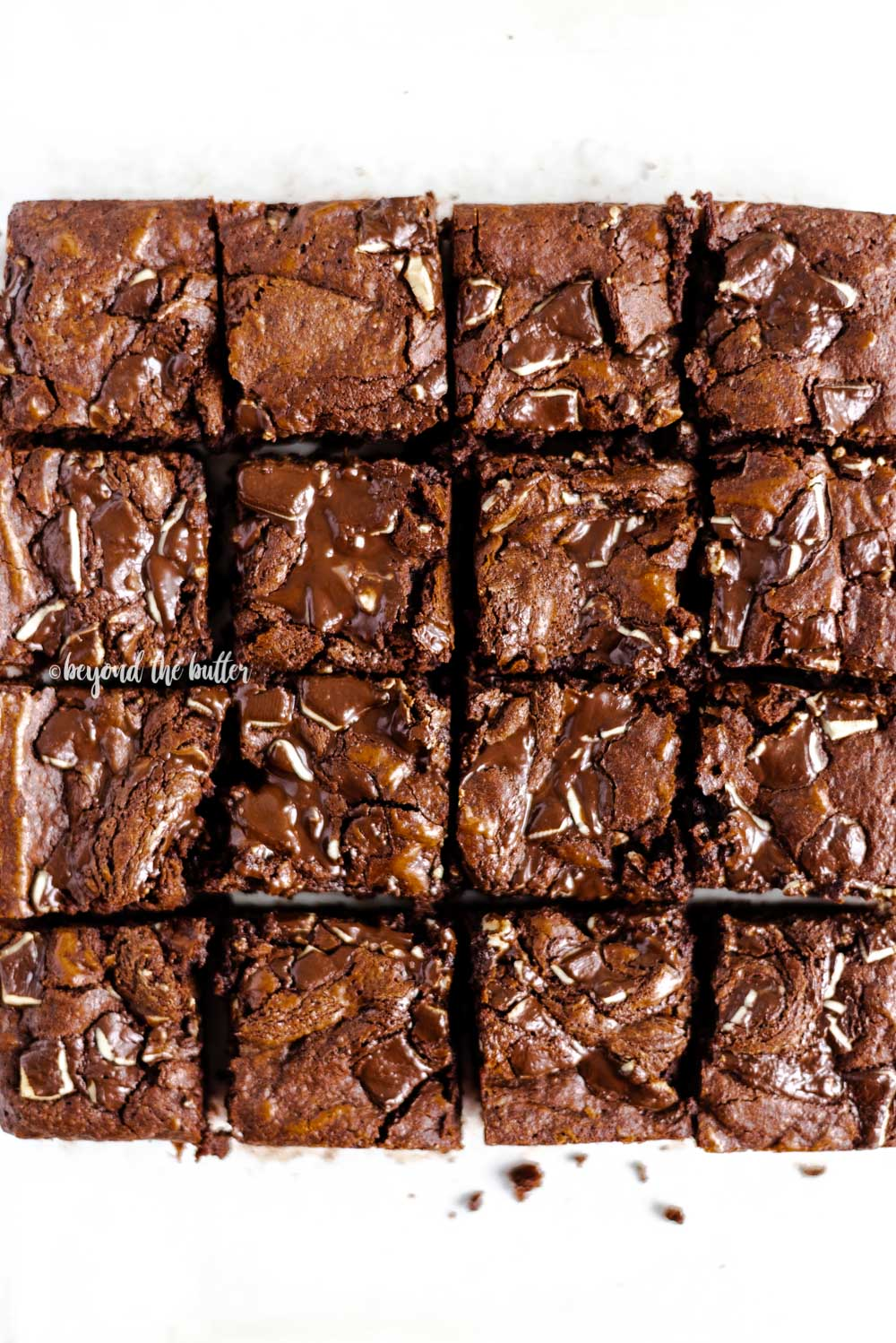 Overhead image of Double Chocolate Mint Brownies cut into squares | All Images © Beyond the Butter™