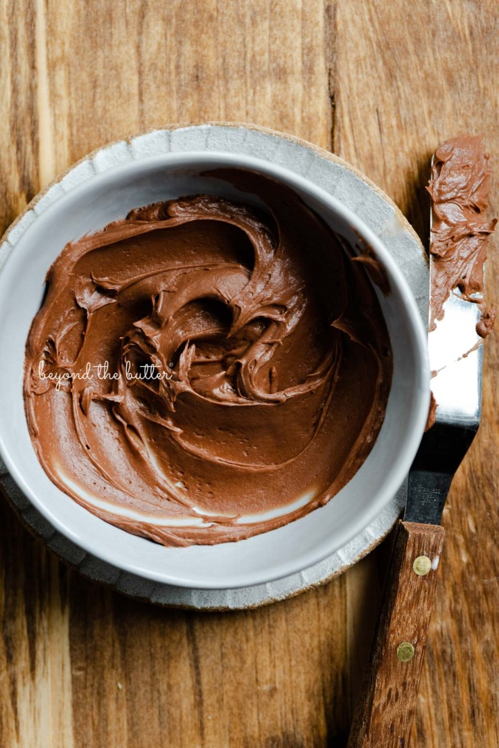 Chocolate cream cheese frosting for the banana chocolate chip snack cake | All images © Beyond the Butter®