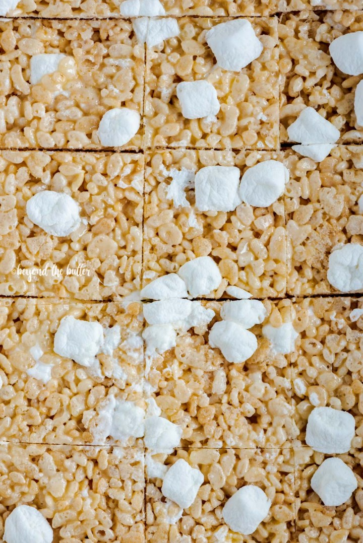 Closeup overhead image of just cut rice krispie treats | All Images © Beyond the Butter™