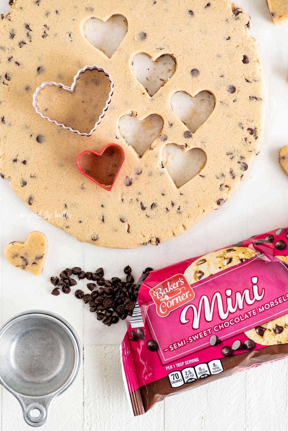 Cutting out cookie dough hearts | All Images © Beyond the Butter, LLC
