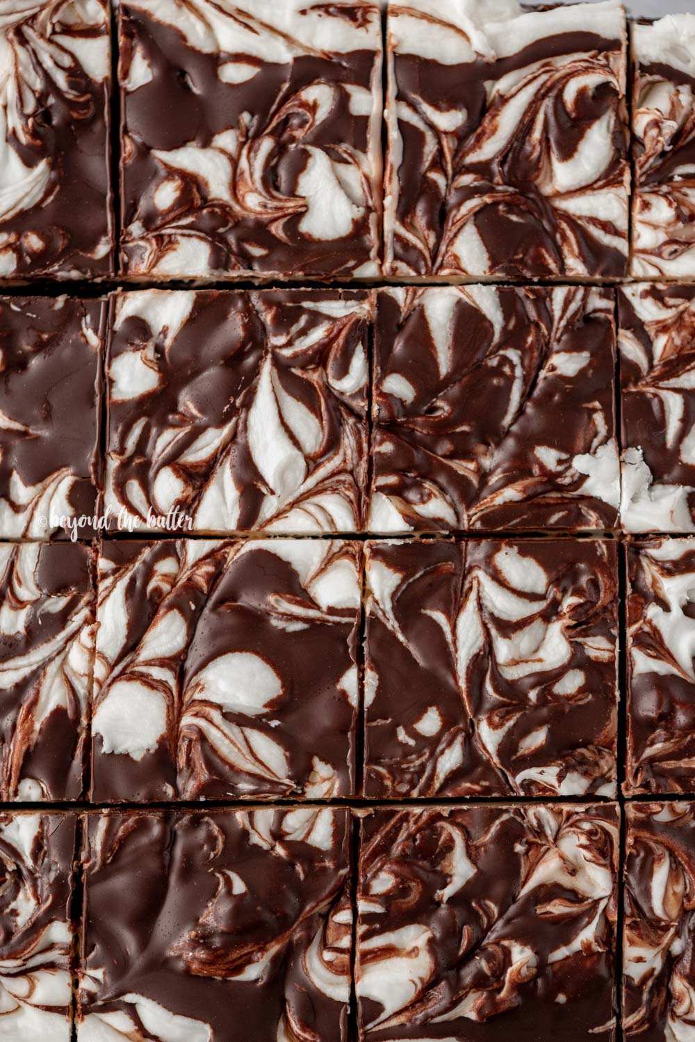Close up of cut Chocolate Peppermint Swirled Brownies | All Images © Beyond the Butter, LLC