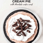 Overhead Pinterest image of No-Bake Chocolate Cream Pie garnished with Cool Whip and chocolate curls | All Images © Beyond the Butter™