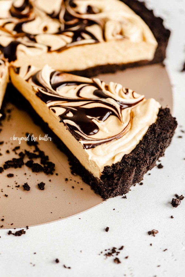 Angled image of a sliced chocolate peanut butter tart | All Images © Beyond the Butter™