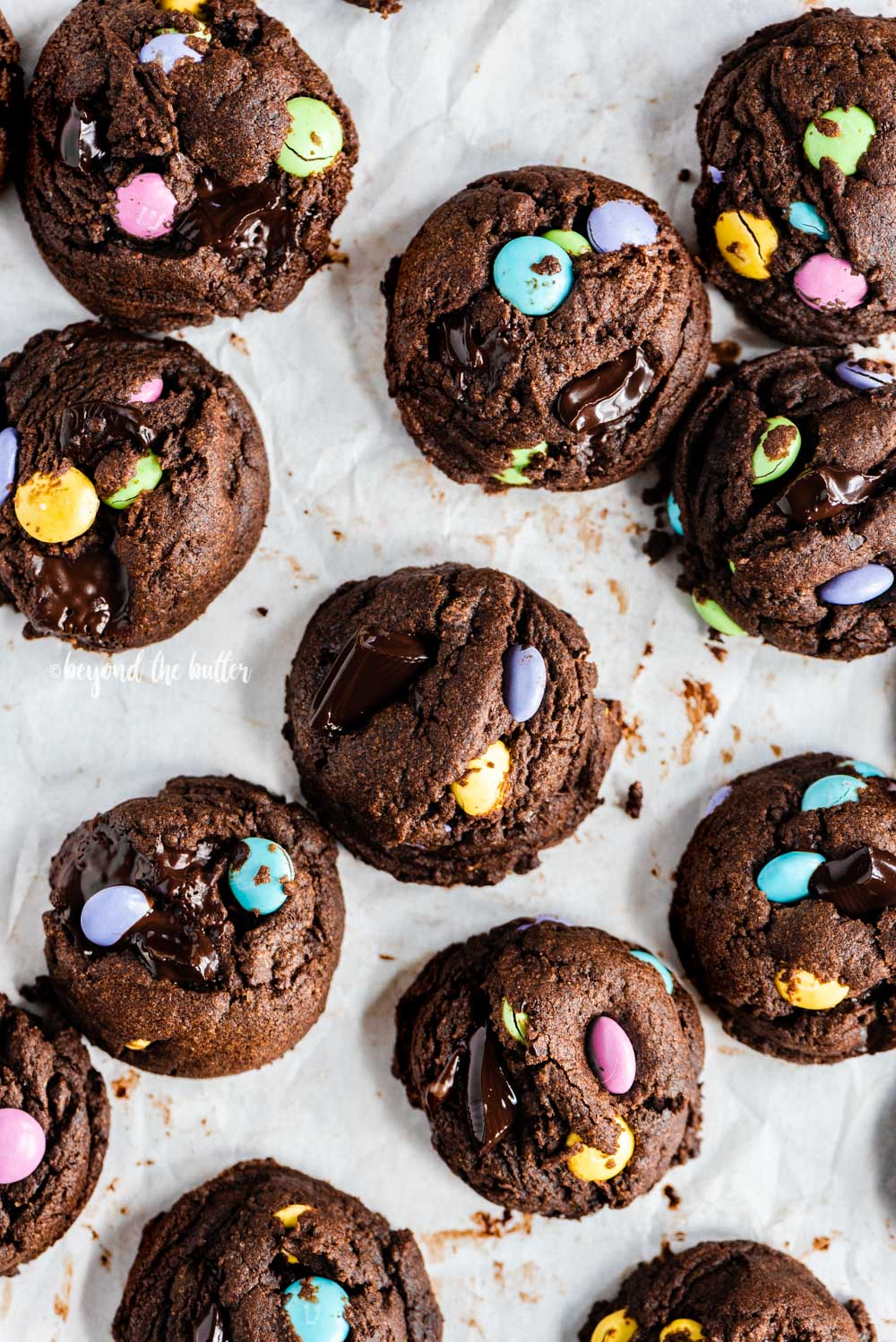 Overhead image of scattered double chocolate m&m cookies | All Images © Beyond the Butter™