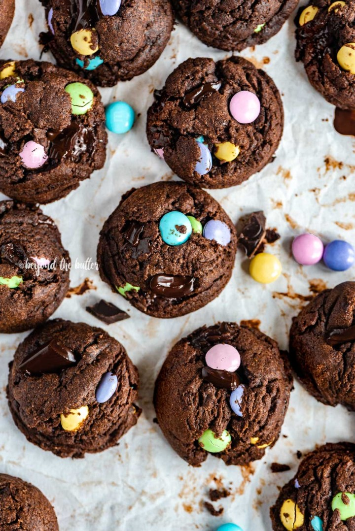 Overhead image of just baked double chocolate chunk m&m cookies | All Images © Beyond the Butter™