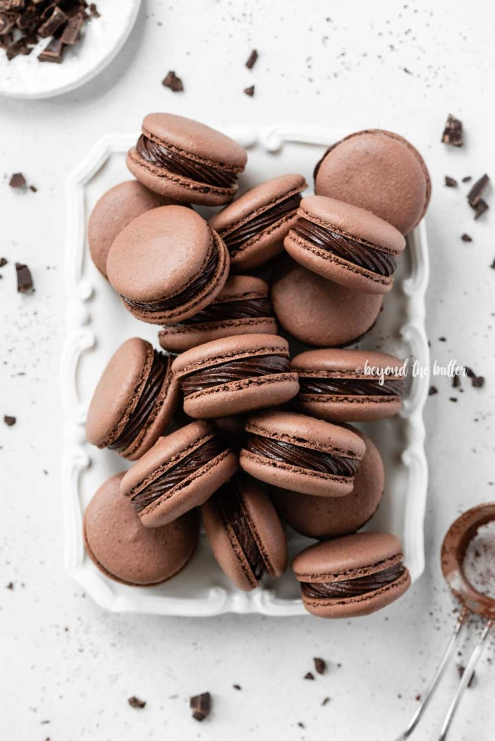 Plate full of dark chocolate macarons | All Images © Beyond the Butter™
